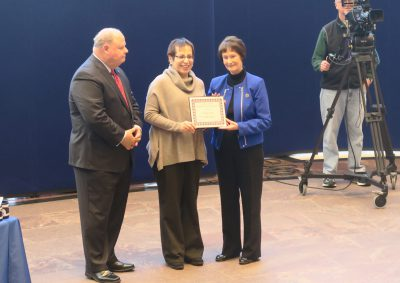 Left to right: Fairfax Fairfax County Executive Ed Long, Norma Lopez, and Board of Supervisors Chair Sharon Bulova.